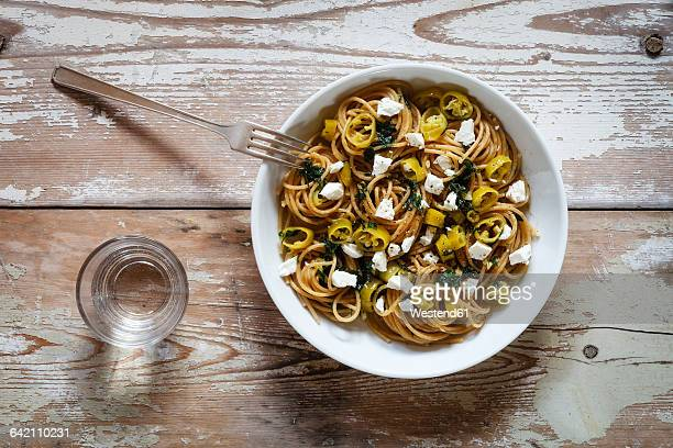 Plate of spelt whole grain spaghetti with feta and chili peppers