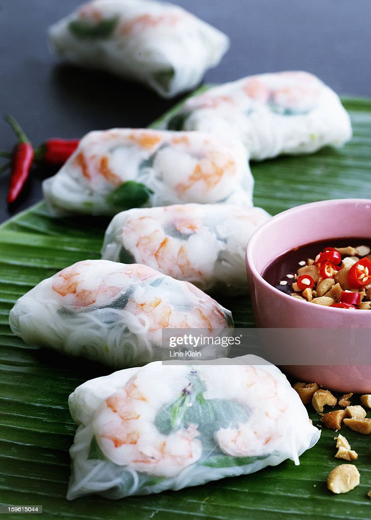 Plate of spring rolls with dipping sauce : Stock Photo