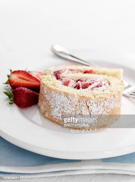 Plate of strawberry swiss roll