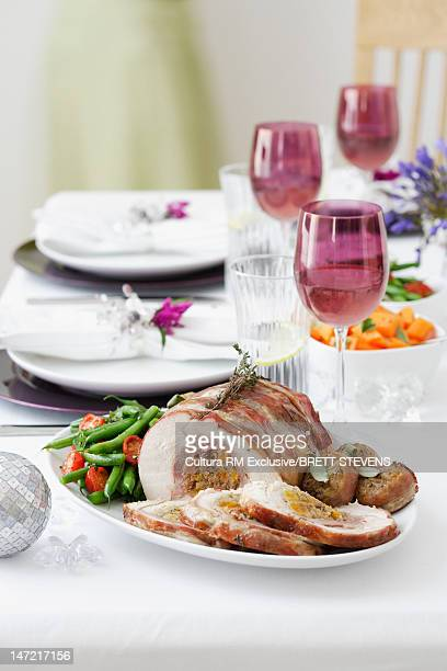 Plate of stuffed meat with vegetables