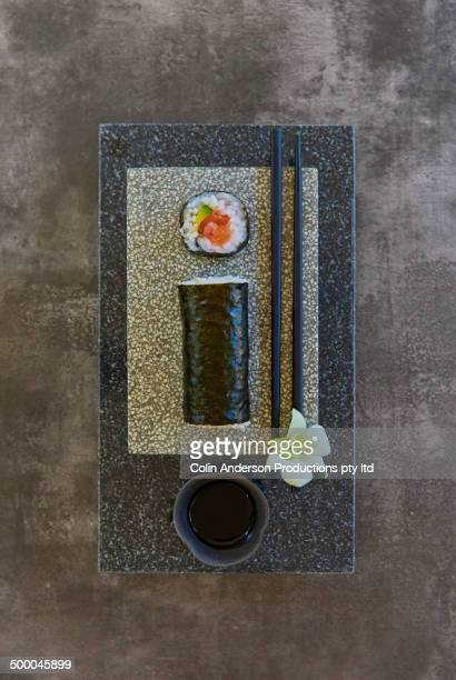 Plate of sushi with flower and chopsticks
