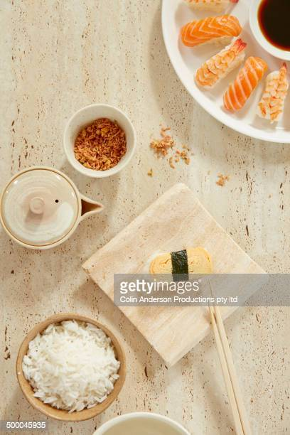 Plate of sushi with rice and ginger