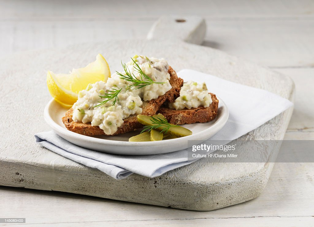 Plate of toast with herring and lemon : Stock Photo