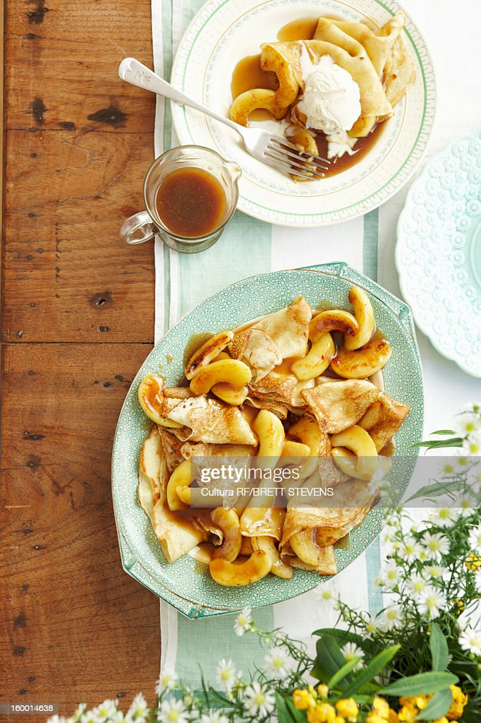 Plate of toffee apple pancakes and sauce : Stock Photo