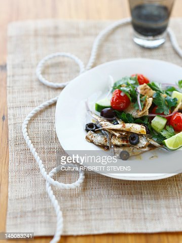 Plate of vegetables with fish : Stock Photo