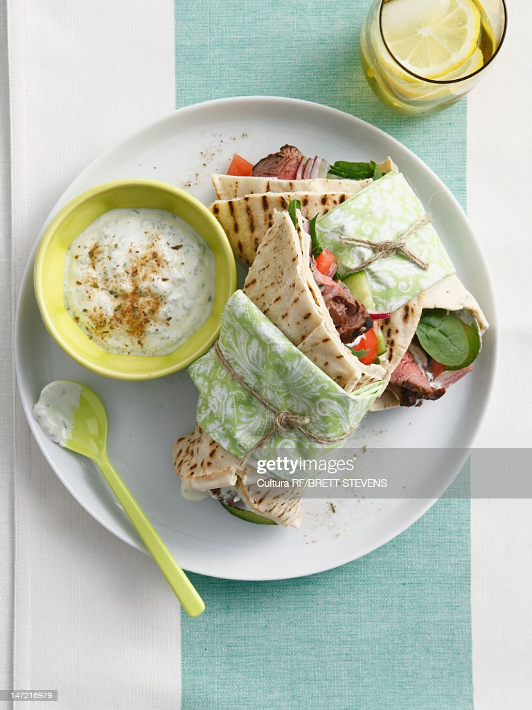 Plate of wrap with dipping sauce : Stock Photo