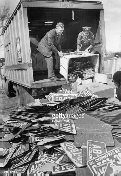 Plate Recycling Slated Walter Fox left Denver Post Office superintendent of vehicle operations and Joseph Harlan a postal driver unload carts...