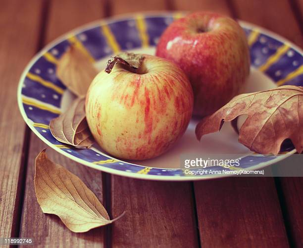 Plate with apples and autumn leaves