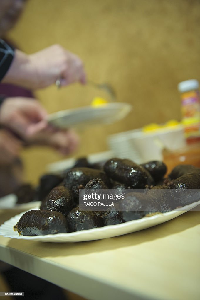 A plate with Estonian blood sausages is on a table in Tallinn, Estonia, on December 15, 2012. As Christmas looms, residents of the Baltic state of Estonia are bracing to wolf down tonnes of blood sausage, a staple of their holiday table.