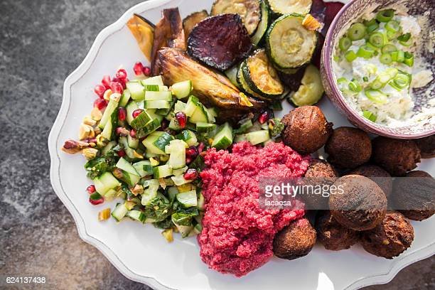 Plate with Falafel, Hummus, Vegetables and Salad