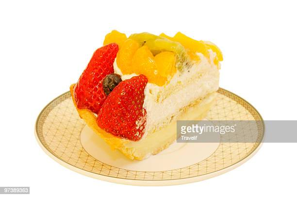 Plate with fruit cake isolated on white
