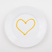 Plate with heart made of mustard