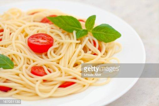 plate with spaghetti, tomato and basil : Stock Photo