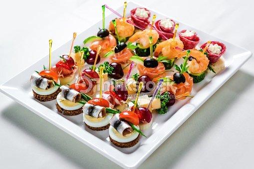 assiette de fruits de mer et de viande avec divers horsd uvre photo thinkstock. Black Bedroom Furniture Sets. Home Design Ideas