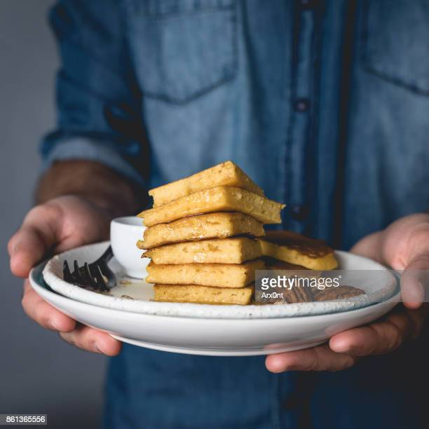 Plate with vegetarian pancakes in hands