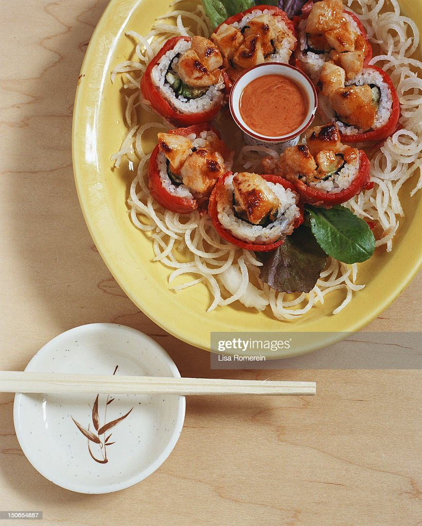 Plate with volcano sushi roll on noodles w/sauce : Stock Photo