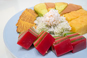 A plated of assorted nonya snacks and cakes