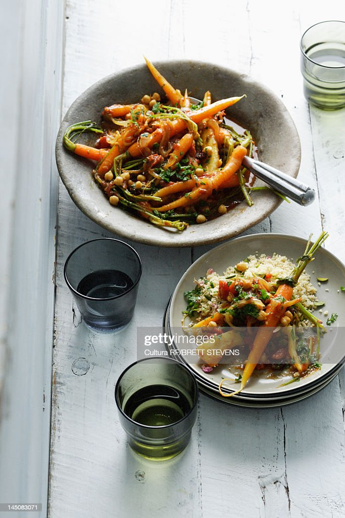 Plates of carrots and vegetables : Stock Photo