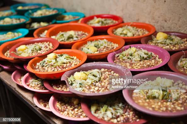 Plates of food are ready to be given out to the pupils at Kibera School Nairobi The school consists of 6 teachers with approximately 60 children in...