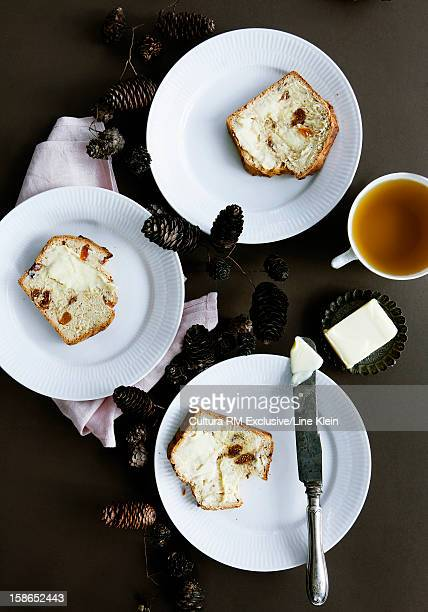 Plates of fruit cakes with butter