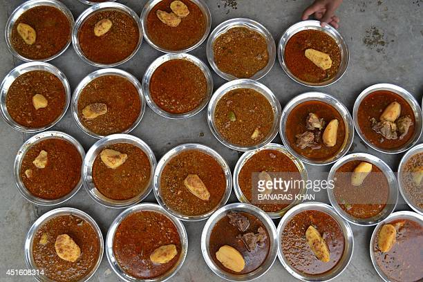 Plates of Iftar food are prepared for Pakistani Muslim men to breaking their fast during the holy fasting month of Ramadan in Quetta on July 2 2014...