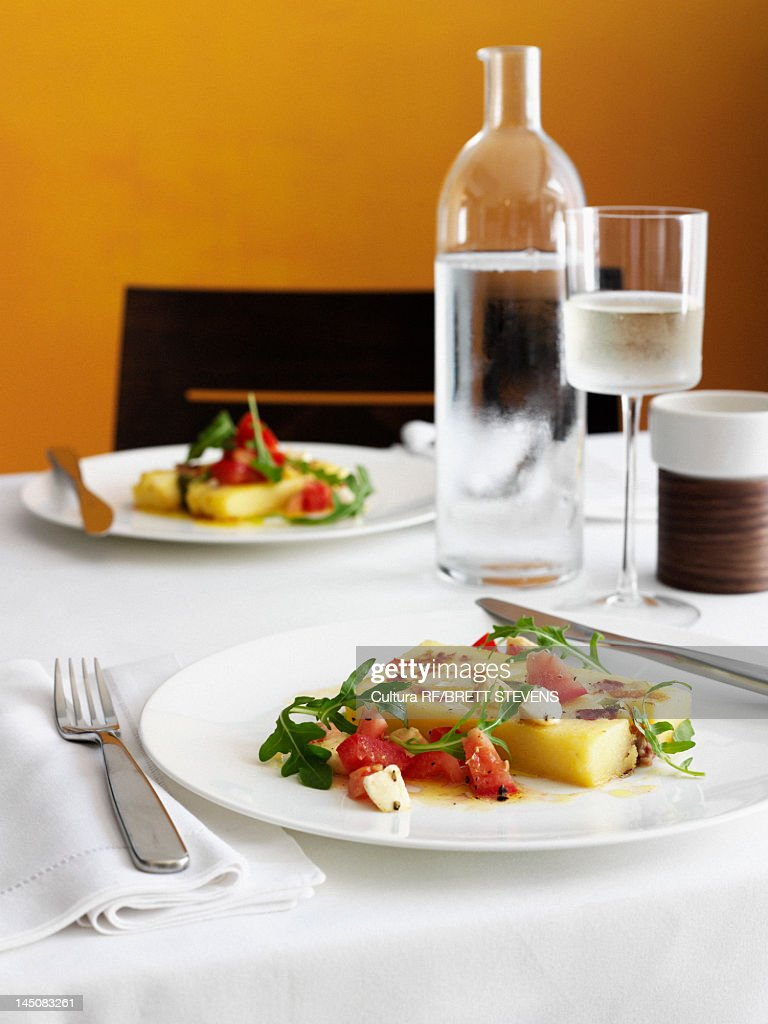 Plates of melon salad on table : Stock Photo