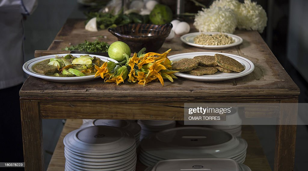 Plates of mosquito eggs with nopal (cactus leaves) with pumpkin flowers (L) at Don Chon restaurant's kitchen on August 18, 2013. The Restaurant Bar Don Chon, in downtown Mexico City, was founded in 1924 specializes in exotic Mexican food.