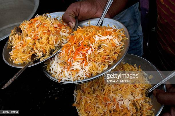 Plates of mutton biryani are served at an outside eatery in Lucknow on November 22 2014 Biryani is a South Asian dish made with rice spices and meat...