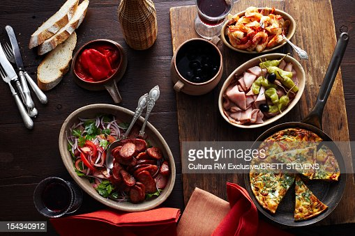 Plates of quiche, meats and vegetables