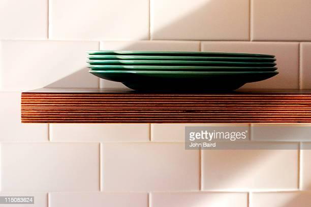 Plates  on shelf.
