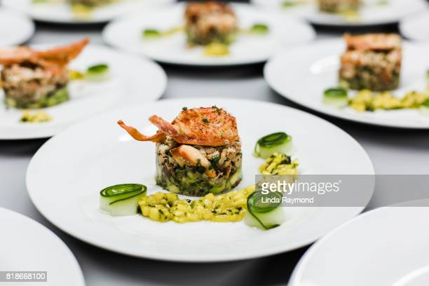 Plates with lobster risotto in a restaurant