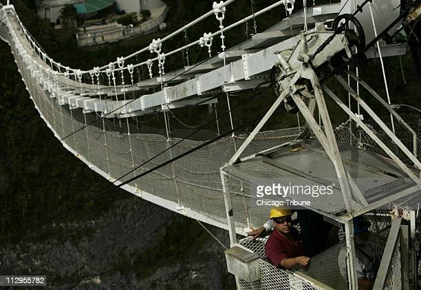 Platform workers make their way up a cable car to the Arecibo telescope in Arecibo Puerto Rico March 9 2007 The National Science Foundation's Arecibo...