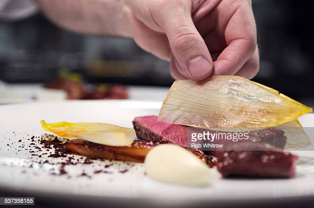 plating up food during service