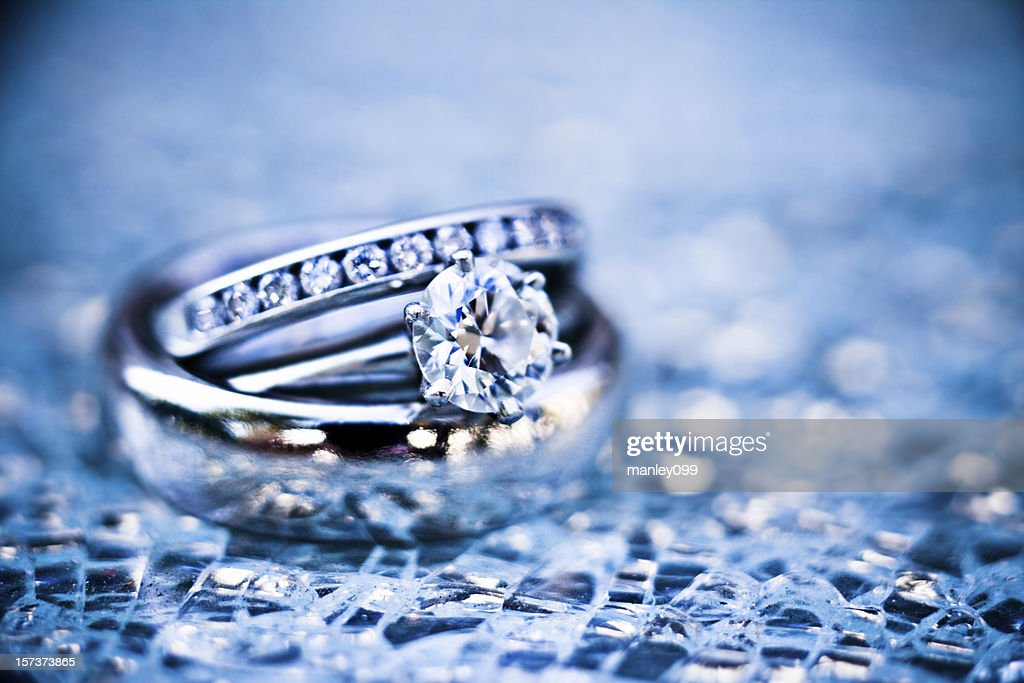 platinum rings on shattered glass (ice blue) : Stock Photo