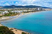 a panoramic view of the Platja den Bossa beach in Ibiza Town, in Ibiza Island, Balearic Islands, Spain