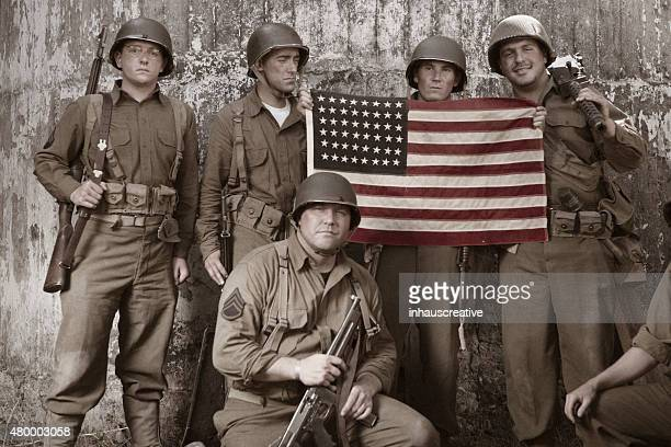WW2 platoon holding American Flag