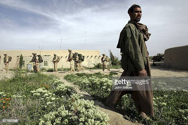 A platoon of British soldiers passes an Afghan farmer on March 23 2006 in Musa Qala in the southern Afghan province of Helmand British forces have...