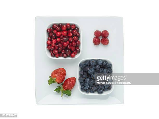 Platter of berries isolated on white