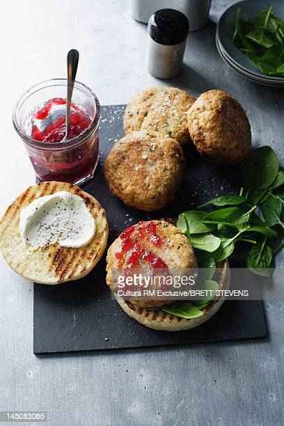 Platter of chicken burgers with jam