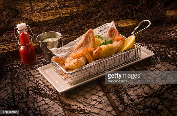 Platter of fish and chips with condiments