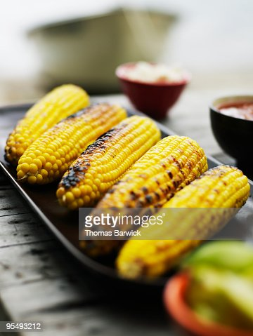 Platter of grilled organic sweet corn on the cob