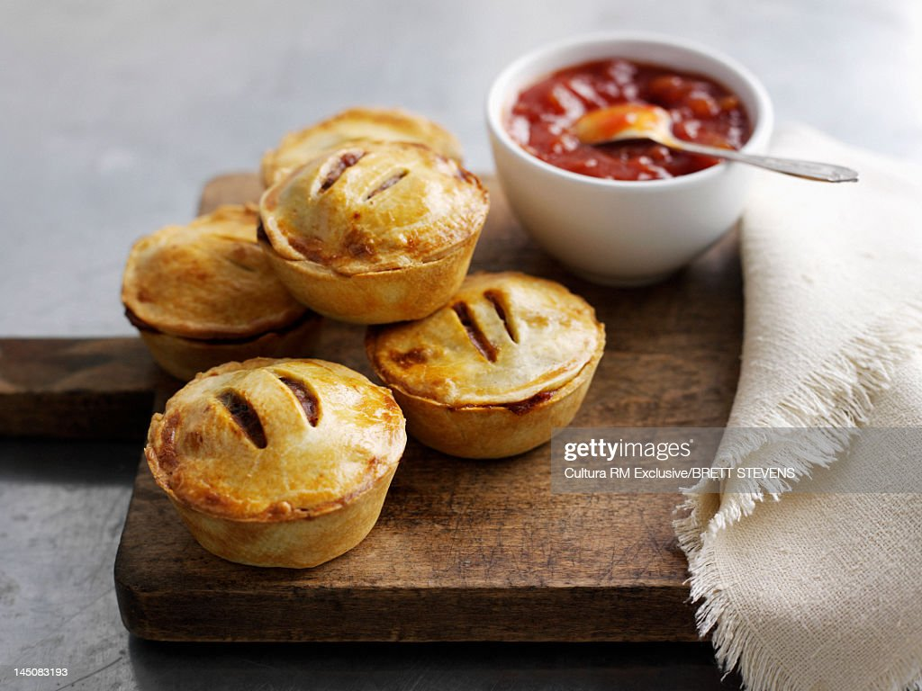 Platter of pies and sauce : Stock Photo