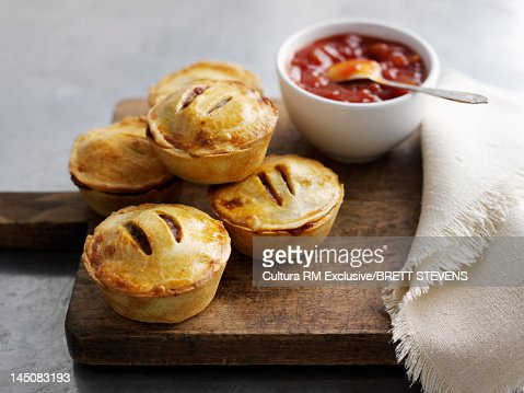 Platter of pies and sauce