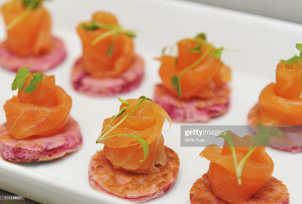 A platter of salmon canapes, food akin to that which is usually served at royal receptions held at at Buckingham Palace on March 25, 2011 in London, England. Prince Prince William will marry his long term girlfriend Kate Middleton on April 29, 2011 at Westminster Abbey and it was reported that the couple had chosen two Wedding cakes for their big day - a 'multi-tiered traditional fruit case with a floral design and a chocolate biscuit cake.'