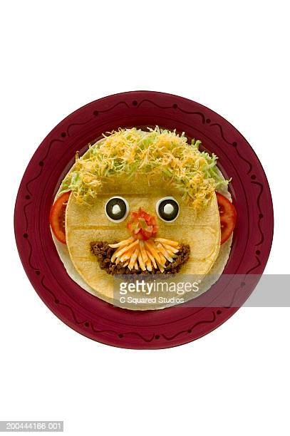 Platter with face made from tortilla