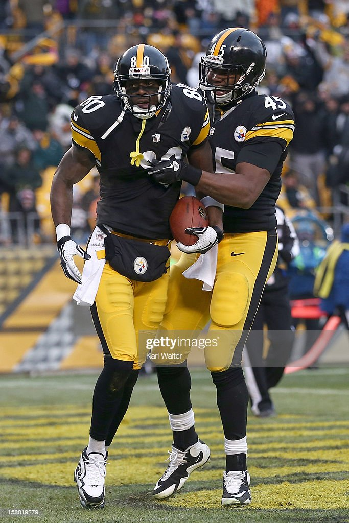 Plaxico Burress #80 and Leonard Pope #45 of the Pittsburgh Steelers celebrate after Burress' touchdown in the fourth quarter of their game against the Cleveland Browns at Heinz Field on December 30, 2012 in Pittsburgh, Pennsylvania.
