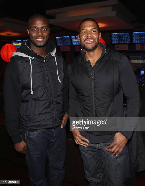 Plaxico Burress and Michael Strahan attend the 2014 John Starks Foundation Celebrity Bowling Tournament at Lucky Strike on February 25 2014 in New...
