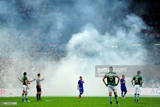 Play is briefly stopped to remove a flare from the field of play during the UEFA EURO 2012 group C between Ireland and Croatia at The Municipal...