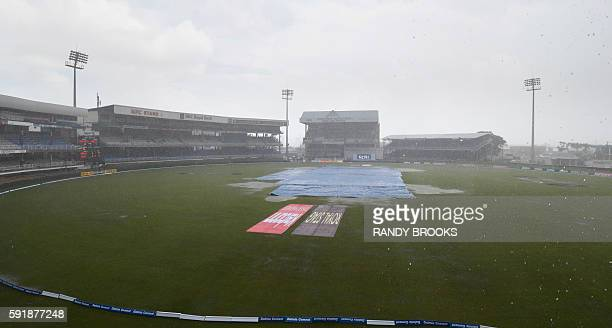 Play is called off due to rain during day 1 of the 4th and final Test between West Indies and India at Queen's Park Oval in Port of Spain Trinidad on...