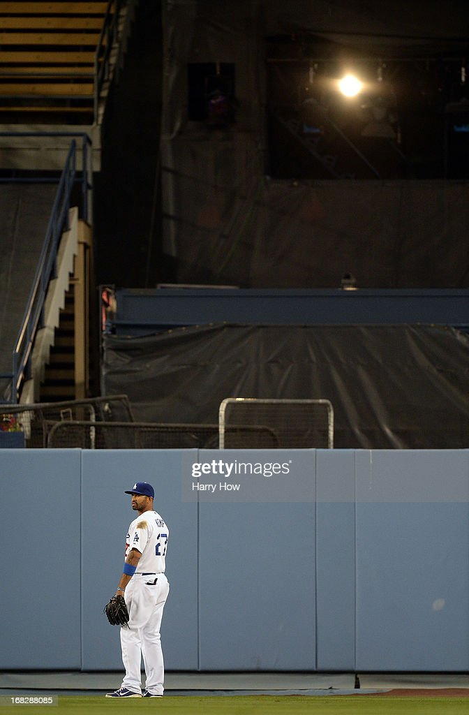 Play is delayed due to a light in center field in front of Matt Kemp #27 of the Los Angeles Dodgers during the sixth inning against the Arizona Diamondbacks at Dodger Stadium on May 7, 2013 in Los Angeles, California.